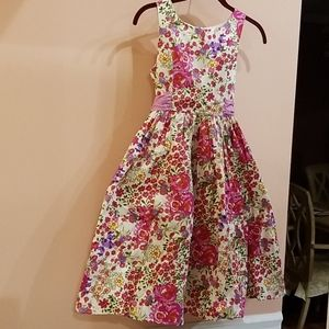 Girls sleeveless dress with flowers over it